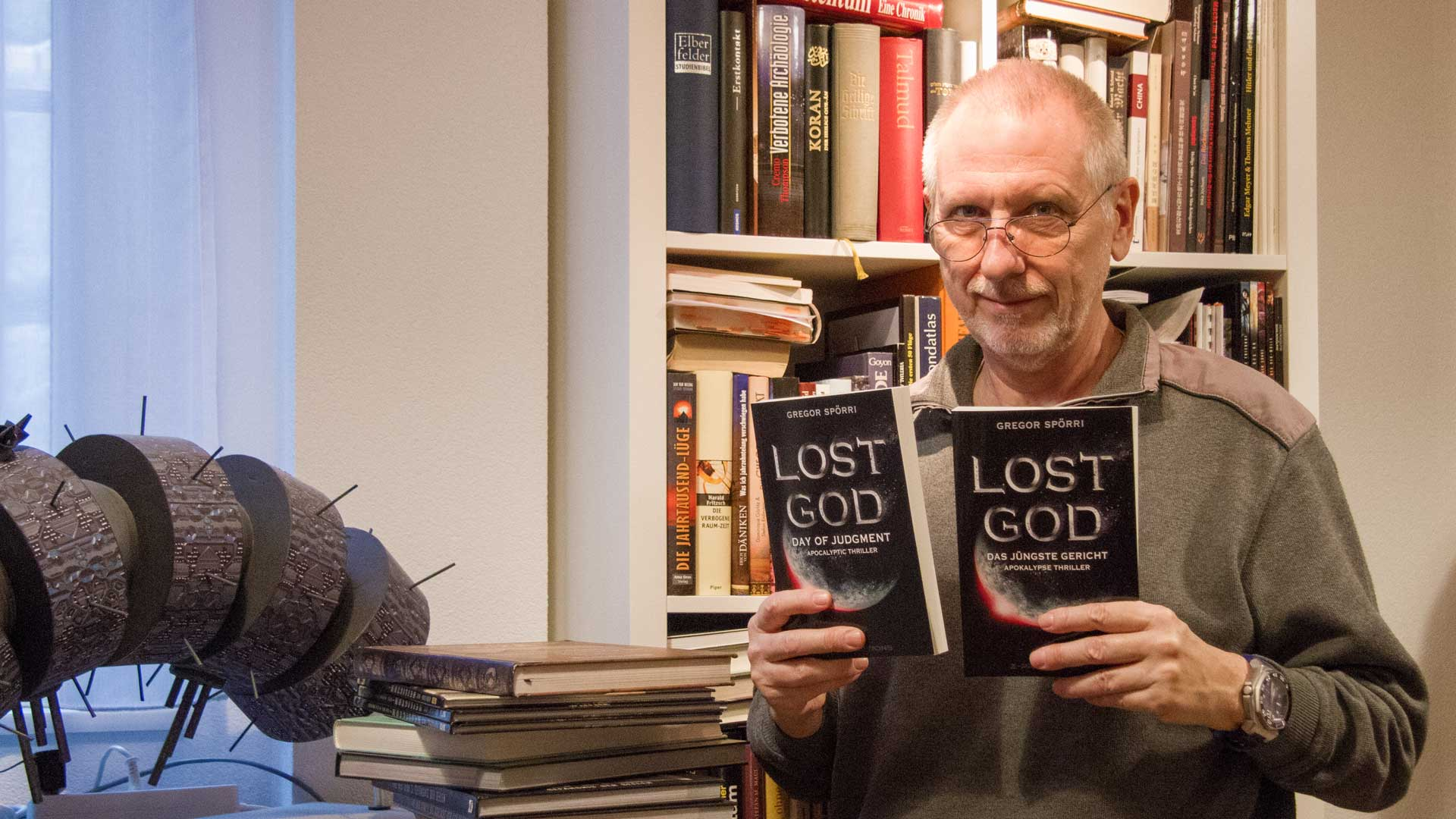 Author Gregor Spörri with his novel LOST GOD: The Last Judgment.