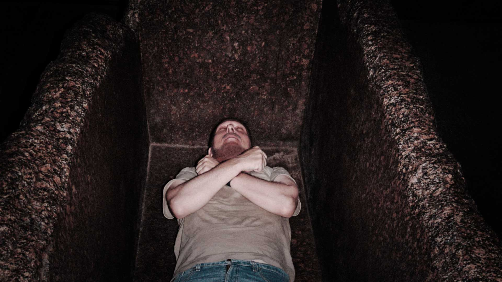 Gregor Spörri meditates during his overnight stay in the pyramid of Cheops in the Royal Chamber sarcophagus (1988).
