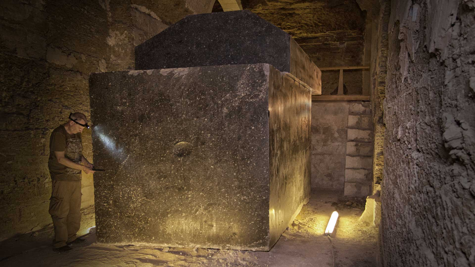 Gregor Spörri examines a 70-ton sarcophagus in the Serapeum of Sakkara