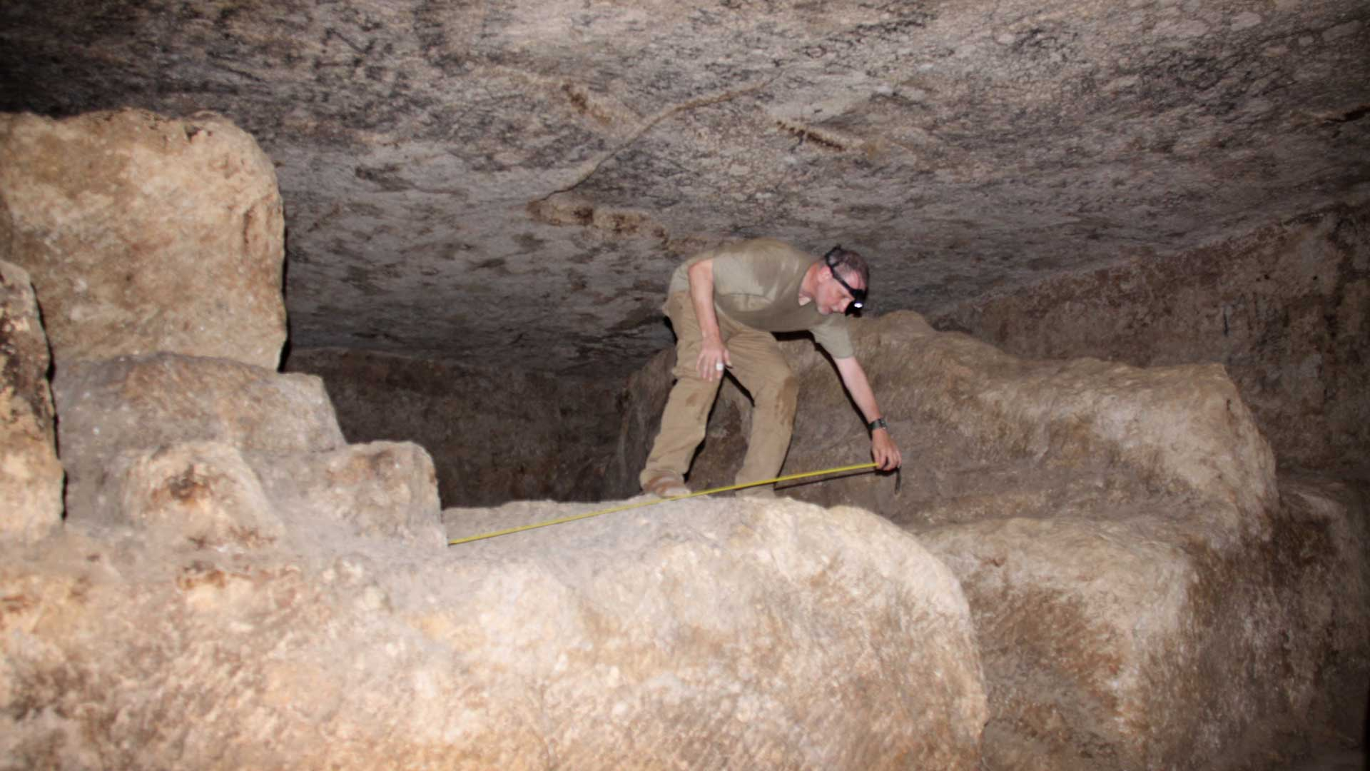 GS surveying the unfinished giant sarcophagi in the rock chamber