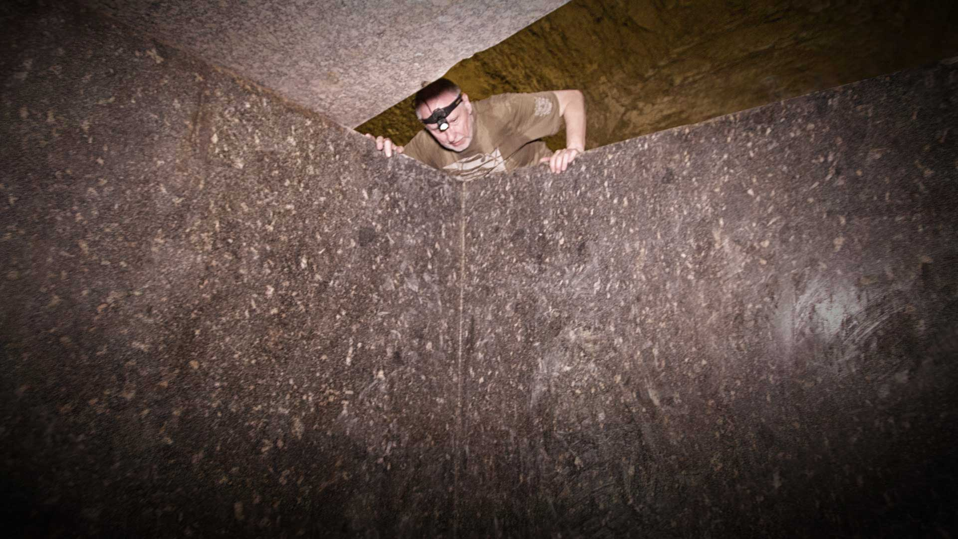 A coffin lid is wide enough open for Gregor Spörri to climb in