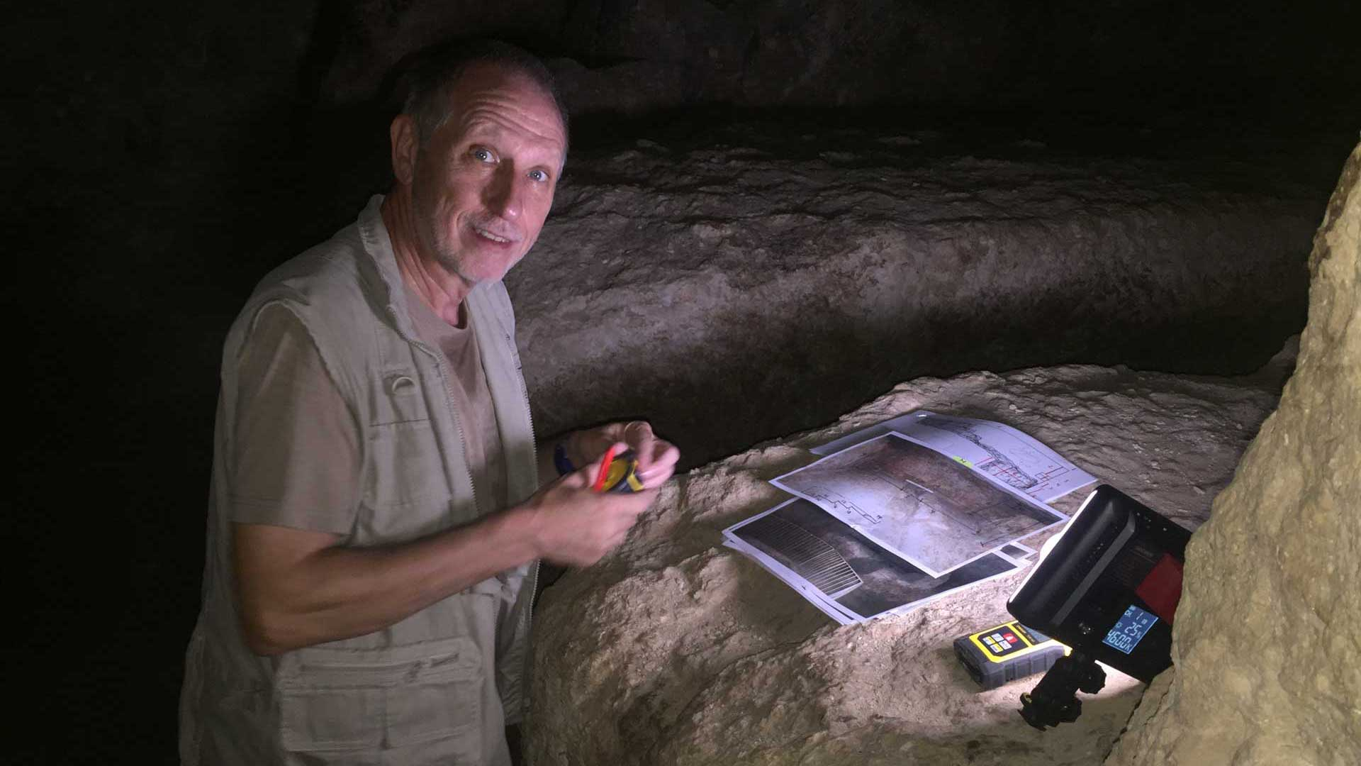 Gregor Spörri surveying the rock chamber under the Great Pyramid.